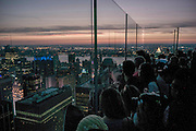 USA, New York: A selection of pictures from the last week.<br /> Visitors on the observation deck of the Rockefeller Centre look out over New York City during sunset . Rick Findler / Story Picture Agency