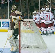 10/10/06 University of Nebraska at Omaha celebrates a goal against  Mantitoba  goalie Krister Toews blocks a shotduring an exhibition game..(Chris Machian/Prairie Pixel Group)