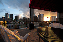 Houston, Texas skyline viewed from residential balcony of high-rise at sunset.