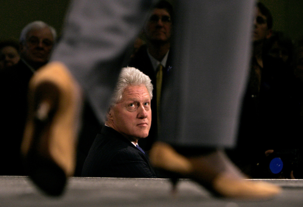 Former U.S. President Bill Clinton listens to his wife U.S. Senator and Democratic Presidential Candidate Hillary Rodham Clinton (D-NY) speak at a campaign fund-raiser in Washington, March 20, 2007.   REUTERS/Jim Young
