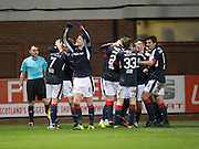 Dundee players celebrate after Hearts&rsquo; Callum Paterson's own goal had completed a Christmas miracle comeback for the Dark Blues Dundee v Hearts in the Ladbrokes Scottish Premiership at Dens Park, Dundee. Photo: David Young<br /> <br />  - &copy; David Young - www.davidyoungphoto.co.uk - email: davidyoungphoto@gmail.com