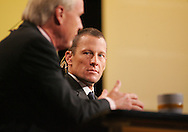 27 August 2007: Lance Armstrong (right) listens to MSNBC Hardball host Chris Matthews (left) ask a question at the LIVESTRONG Presidential Cancer Forum in Cedar Rapids, Iowa on August 27, 2007.