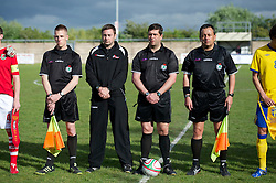 FLINT, WALES - Thursday, May 12, 2011: Referee Mark Petch with assistants Peter Kewley and Michael Gray and fourth official Nick Pratt before the Men's Under-17's International Friendly match between Wales and Sweden at Cae-y-Castell. (Photo by David Rawcliffe/Propaganda)