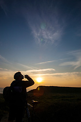 Silhouette of Man Drinking Water at Sunset