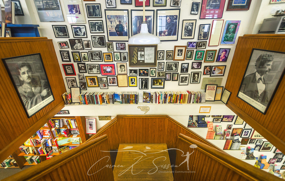 Photographs of authors and author signings fill the walls at Square Books, May 30, 2015, in Oxford, Mississippi. To the left is William Faulkner, and to the right is Mark Twain. The family-owned bookstore was founded in 1979 by Richard and Lisa Howorth and is considered to be one of the catalysts prompting downtown revitalization in Courthouse Square.  (Photo by Carmen K. Sisson/Cloudybright)