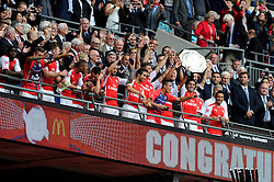 Arsenal's Mikel Arteta celebrates with his team mates as he lifts the Community Shield - Photo mandatory by-line: Dougie Allward/JMP - Mobile: 07966 386802 10/08/2014 - SPORT - FOOTBALL - London - Wembley Stadium - Arsenal v Manchester City - FA Community Shield
