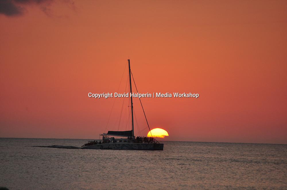 Beaches Resort catamaran silhouetted against setting sun