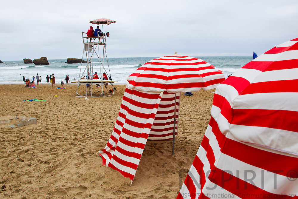 BIARRITZ - FRANCE - 26 JULY 2010 --  Striped beach changing hut or tents at the beach. PHOTO: ERIK LUNTANG