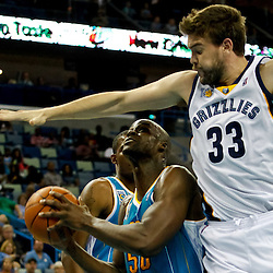 October 9, 2010; New Orleans, LA, USA; Memphis Grizzlies center Marc Gasol (33) defends against New Orleans Hornets center Emeka Okafor (50) during the first quarter of a preseason game at the New Orleans Arena. Mandatory Credit: Derick E. Hingle
