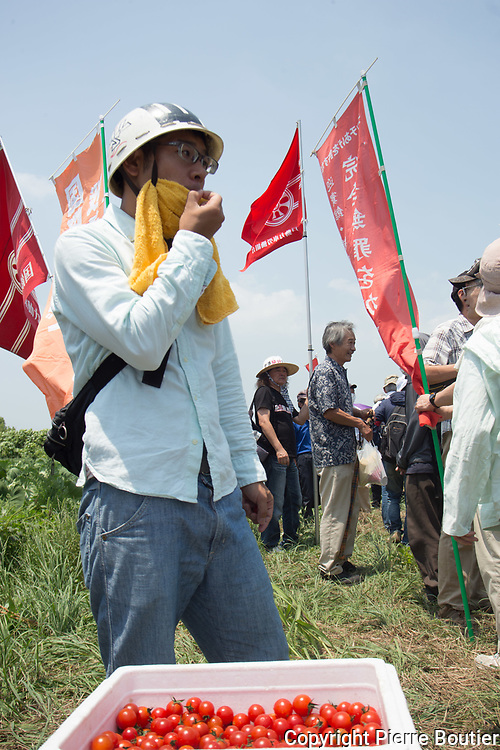 July 9,2017_Tokyo,Chiba   farmers and revolutionnary leagues fighting against the expropriation of their land by Narita airport company who want to expand the land of airport . 50 years after the first actions of resistance, and a long  struggle where there were more than 6500 wounded and 3300 arrests and two deaths in confrontations with the police anti Riots, groups from the new left, such as the Zengakuren, the farmers' league, the communist league, anarchist groups are gathering on the plots of Sir Takao Ito who continues to fight against his expropriation. Pierre Boutier, Polaris