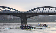 Putney, GREAT BRITAIN,  left, crew Personality and crew Looks, race towards Barnes Rail Bridge, during the 2008 Varsity/Cambridge University Trial Eights, raced over the championship course. Putney to Mortlake, Tue. 16.12.2008. [Mandatory Credit, Peter Spurrier/Intersport-images..Crew Personality. Bow Dan SHAUGHNESSY, 2. Shane O'MARA, 3. John CLAY, 4. Ryan MONAGHAN, 5. Fred GILL, 6. Deaglan McEACHERN, 7. Hardy CUTBASCH, stroke,. Rob WEITEMAYER and cox Rebecca DOWBIGGIN...Crew Looks;.Bow James STRAWSON. 2. Joel JENNINGS, 3. Code STERNAL, 4 Peter MARSLAND, 5. George NASH, 6. Henry PELLY, 7. Tom RANSLEY, stroke Silas STAFFORD and Cox Helen HODGES.. Varsity Boat Race, Rowing Course: River Thames, Championship course, Putney to Mortlake 4.25 Miles,