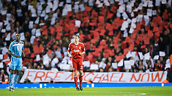 LIVERPOOL, ENGLAND - Monday, December 1, 2008: Liverpool's Jamie Carragher plays in front of supporters on the Spion Kop as they show their support for Michael Shields, the Liverpool fan imprisoned in 2005 for a crime he did not commit before the Premiership match against West Ham United at Anfield. (Photo by David Rawcliffe/Propaganda)