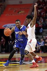 31 December 2014:  Tre' Bennett struggles to get to the three point line while guarded by Paris Lee during an NCAA Division 1 Missouri Valley Conference (MVC) men's basketball game between the Indiana State Sycamores beat the Illinois State Redbirds 63-61 at Redbird Arena in Normal Illinois