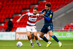 Jon Taylor of Doncaster Rovers takes on Luke Leahy of Bristol Rovers - Mandatory by-line: Robbie Stephenson/JMP - 19/10/2019 - FOOTBALL - The Keepmoat Stadium - Doncaster, England - Doncaster Rovers v Bristol Rovers - Sky Bet League One
