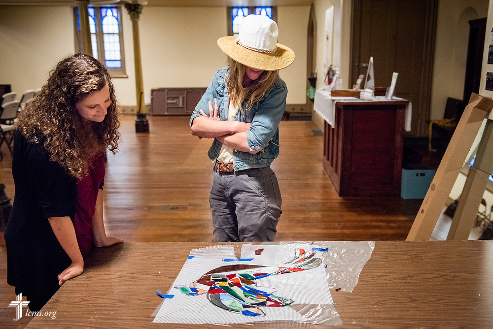Artist Rachel Ziegler and Deaconess Kelly Jacob, coordinator of the Bridge Ministry, survey a bird constructed from stained glass destined for a new mural, at Prince of Peace Lutheran Church in the Over-the-Rhine neighborhood of Cincinnati, on Wednesday, May 16, 2018, in Cincinnati. LCMS Communications/Frank Kohn