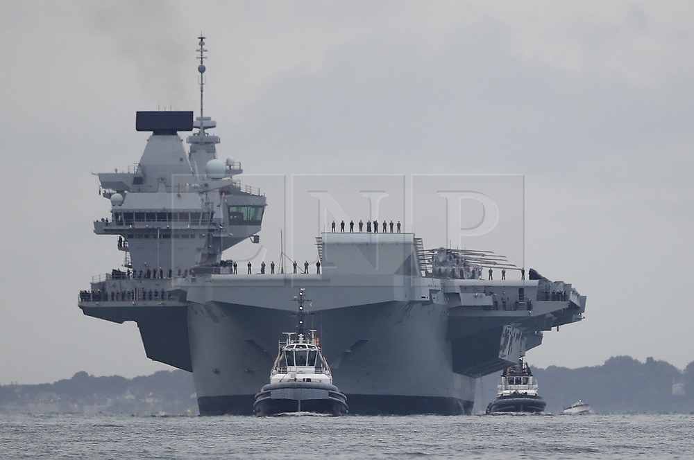 © Licensed to London News Pictures. 16/08/2017. Portsmouth, UK. The Royal Navy's new aircraft carrier HMS Elizabeth heads for her home port of Portsmouth for the first time. The new ship at 65,000 tonnes is the biggest warship ever built in the UK. Photo credit: Peter Macdiarmid/LNP