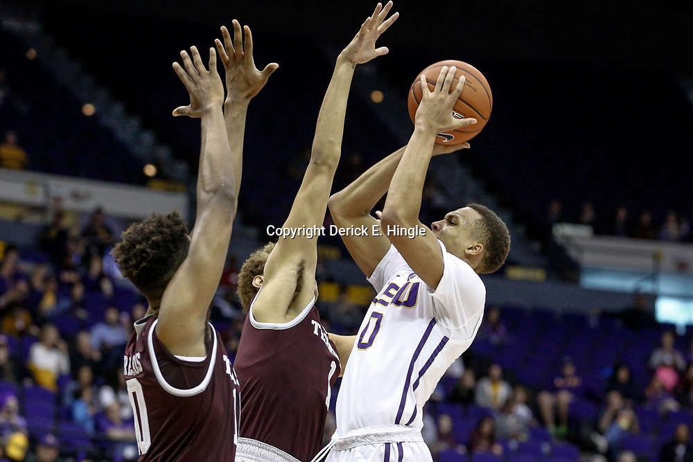 Feb 4, 2017; Baton Rouge, LA, USA; LSU Tigers guard Brandon Sampson (0) shoots over Texas A&M Aggies forward DJ Hogg (1) and center Tonny Trocha-Morelos (10) during the second half at the Pete Maravich Assembly Center. Texas A&M defeated LSU 85-73. Mandatory Credit: Derick E. Hingle-USA TODAY Sports