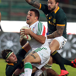 PADUA, ITALY - NOVEMBER 22: Marcell Coetzee and Francois Hougaard of South Africa tackling Andrea Manici of Italy during the Castle Lager Outgoing Tour match between Italy and South African at Stadio Euganeo on November 22, 2014 in Padua, Italy. (Photo by Steve Haag/Gallo Images)