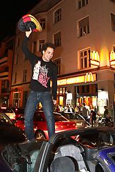 23.06.2010, Leopoldstrasse Schwabing, Muenchen, GER, FIFA Worldcup, Fanfeier nach Ghana vs Deutschland,  im Bild Fan auf Autokofferaum , EXPA Pictures © 2010, PhotoCredit: EXPA/ nph/  Straubmeier / SPORTIDA PHOTO AGENCY