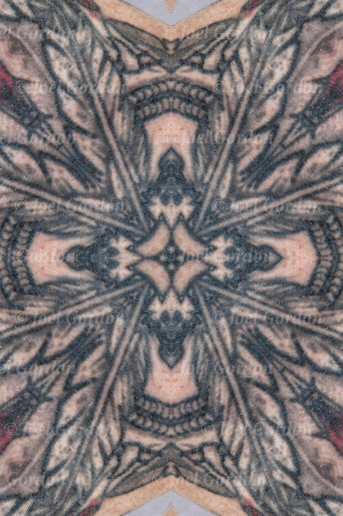Photographic series of digital computer tattoo art, an illusion / fantasy generated from a Eagle Feathers Native American tattoo. <br />