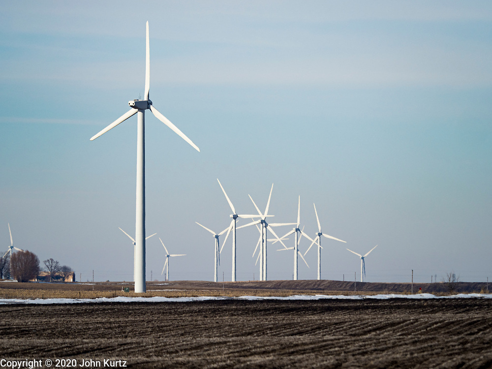 """24 FEBRUARY 2020 - BLAIRSBURG, IOWA:  Wind turbines on a """"wind farm"""" near Blairsburg. There are more than 100 wind turbines at this location. In 2019, Iowa generated more than 41% of its electrical needs with wind power. Iowa is the 2nd leading producer of wind energy in the US, only Texas generates more electricity by wind power. There are more than 4,500 wind turbines in Iowa.      PHOTO BY JACK KURTZ"""
