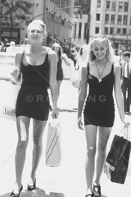 Women in black dresses shopping in New York