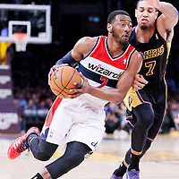 21 March 2014: Washington Wizards guard John Wall (2) drives past Los Angeles Lakers forward Xavier Henry (7) during the Washington Wizards 117-107 victory over the Los Angeles Lakers at the Staples Center, Los Angeles, California, USA.