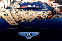 "KNOKKE, BELGIUM - AUGUST-2-2005 - A Bentley which costs 185,000 Euros, cruises Albertplien, which is also known to locals as Place M'as tu vu "" Did you see me? "". (Photo © Jock Fistick)"