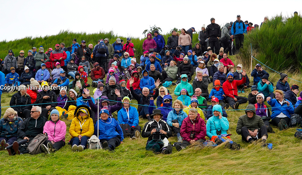 Auchterarder, Scotland, UK. 14 September 2019. Saturday afternoon Fourballs matches  at 2019 Solheim Cup on Centenary Course at Gleneagles. Pictured; Spectators sitting on slope beside the 9th fairway.  Iain Masterton/Alamy Live News