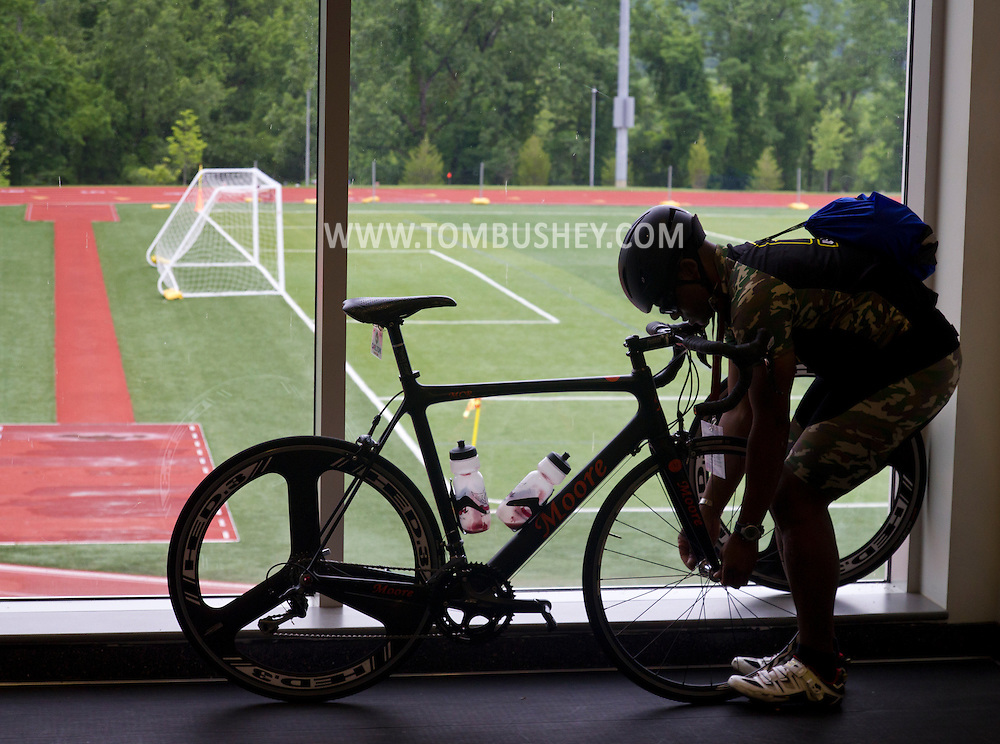 West Point, New York - An athlete prepares his bicycle for a training ride before  the 2014 Army Warrior Trials at the United States Military Academy Preparatory School on Monday, June 9, 2014.<br />  Hosted by the U.S. Army Warrior Transition Command (WTC), the trials determine which athletes will compete at the 2014 Warrior Games this fall in Colorado Springs, Colorado.