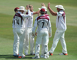 Olly Stone of Northamptonshire celebrates with team mates after Ian Cockbain of Gloucestershire is caught by Alex Wakely bowled by Stone - Photo mandatory by-line: Dougie Allward/JMP - Mobile: 07966 386802 - 09/07/2015 - SPORT - Cricket - Cheltenham - Cheltenham College - LV=County Championship 2