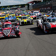 Teams, drivers, officials, and fans prepare for the 86th running of the 24 Hours of Le Mans at the Circuit de la Sarthe in France.