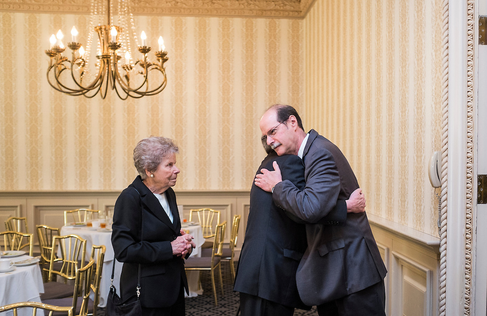 Mark Weinberg, founding dean of the Voinovich School, is congratulated by attendees following the Ohio University State Government Alumni Luncheon on Tuesday, May 5, 2015.  Photo by Ohio University  /  Rob Hardin