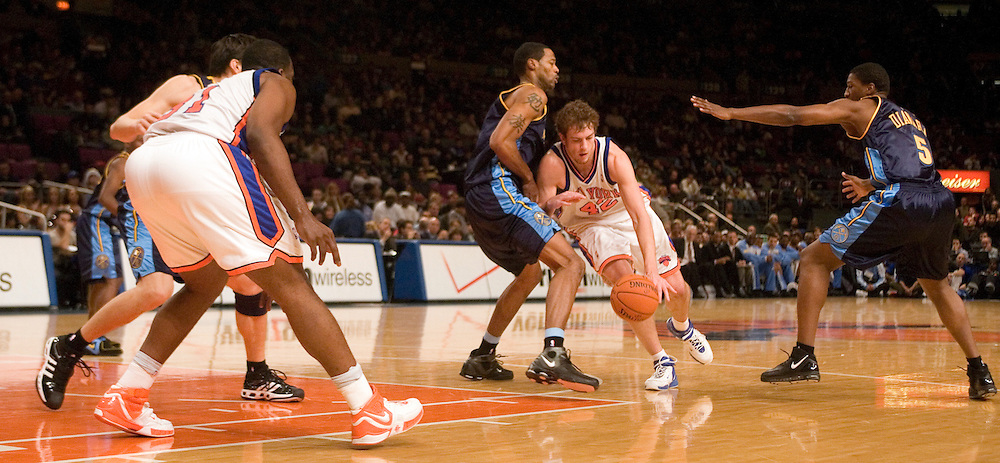 David Lee of the New York Knicks drives into Marcus Camby the Denver Nuggets at Madison Square Garden, New York on Saturday  16 December 2006. (Andrew Gombert for The New York TImes)<br />