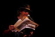 Beat poet Ron Whitehead performs with a jazz band led by David Amram while reading poetry and performing music at the Bowery Poetry Club during the 2007 Howl Festival in New York City.