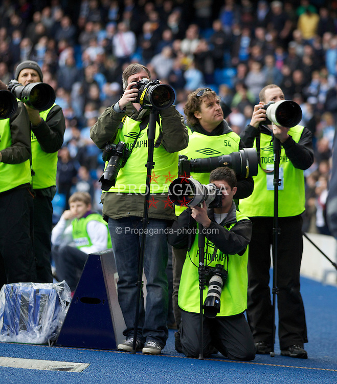 MANCHESTER, ENGLAND - Sunday, April 3, 2011: Photographers before the Premiership match between Manchester City and Sunderland at the City of Manchester Stadium (Photo by Vegard Grott/Propaganda)..