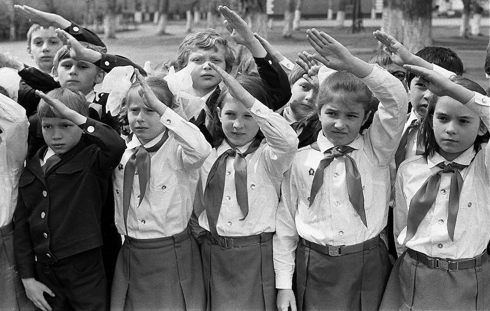 Young Pioneer salute during their school fest in Kemerovo, Eastern Siberia, 1979. The Young Pioneer Organization of the Soviet Union, also Vladimir Lenin All-Union Pioneer Organization was a mass youth organization of the USSR for children of age 10–15 in the Soviet Union between 1922 and 1991..B&W negative film 35mm.