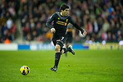 STOKE-ON-TRENT, ENGLAND - Boxing Day Wednesday, December 26, 2012: Liverpool's Luis Alberto Suarez Diaz in action against Stoke City during the Premiership match at the Britannia Stadium. (Pic by David Rawcliffe/Propaganda)
