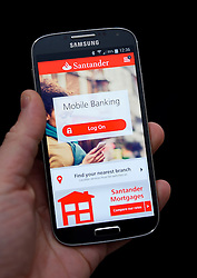 File photo dated 09/03/15 of the Santander banking app, as the bank became the first bank in the UK to enable customers to make payments using their voice.