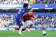Chelsea Midfielder Willian battles with Manchester United Defender Luke Shaw during the Premier League match between Chelsea and Manchester United at Stamford Bridge, London, England on 20 October 2018.