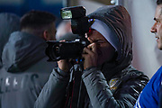 Leeds United defender Gjanni Alioski (10) arrives at the ground and uses a photographer's camera during the EFL Sky Bet Championship match between Leeds United and Hull City at Elland Road, Leeds, England on 10 December 2019.