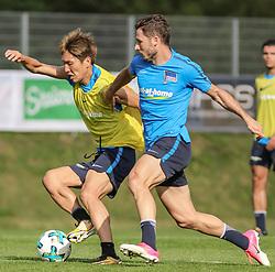 31.07.2017, Athletic Area, Schladming, AUT, Trainingslager, Hertha BSC, im Bild v.l. Genki Haraguchi (Hertha BSC), Mathew Leckie (Hertha BSC) // f.l. Genki Haraguchi (Hertha BSC), Mathew Leckie (Hertha BSC) during the Trainingscamp of the German Bundesliga Club Hertha BSC at the Athletic Area in Schladming, Austria on 2017/07/31. EXPA Pictures © 2017, PhotoCredit: EXPA/ Martin Huber