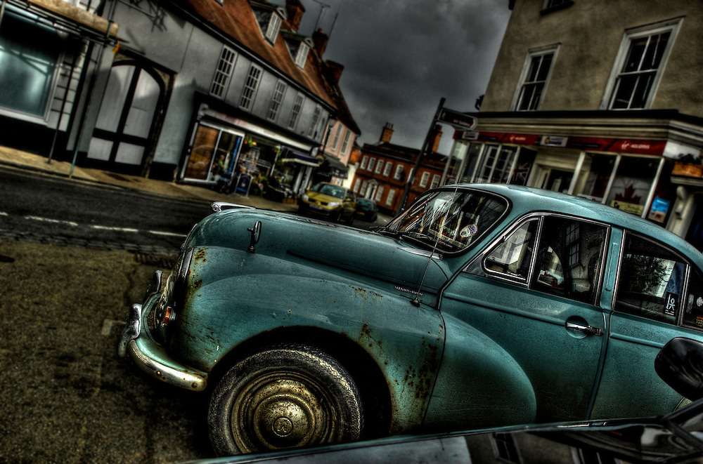 An old Morris Minor car parked in a street in Suffolk old town, England