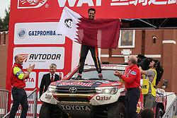 Naser Al-Attiyah (Qatar) waves the flag as he stands on the hood of his car on the podium during the finish ceremony of Silk Way Rally-2018 on Red Square in Moscow, Russia, on Jul. 27, 2018.  Nasser Al-Attiyah and his co-pilot Mathieu Baumel (France) won the second prize in Cars category. (Credit Image: © Evgeny Sinitsyn/Xinhua via ZUMA Wire)