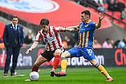 Alex Woodyaard of Lincoln City (30) and Nathan Thomas of Shrewsbury Town (10) battle for the ball during the EFL Trophy Final match between Lincoln City and Shrewsbury Town at Wembley Stadium, London, England on 8 April 2018. Picture by Stephen Wright.