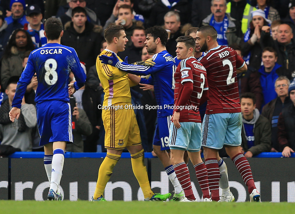 26 December 2014 - Barclays Premier League - Chelsea v West Ham - Tempers flare between Diego Costa of Chelsea and Adrian of West Ham after Branislav Ivanovic of Chelsea is accused of diving -  Photo: Marc Atkins / Offside.