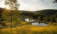 Sunrise over hillside ponds at  Firefly Farm, Hauverville, New York, U.S.A.
