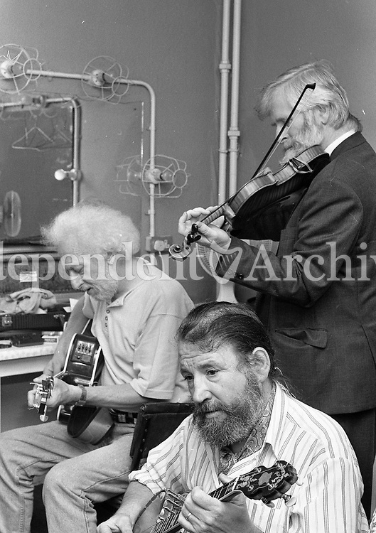 The Dubliners backstage before their Concert in the Olympia Theatre, John Sheahan, Eamon Campbell and Barney McKenna, Dublin, circa August 1992 (Part of the Independent Newspapers Ireland/NLI Collection).
