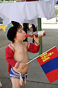 Baden bei Wien, Lower Austria. Naadam Festival of OTSCHIR (Austrian-Mongolian Society) at the Trabrennbahn.<br /> Little boy in traditional wrestling outfit.