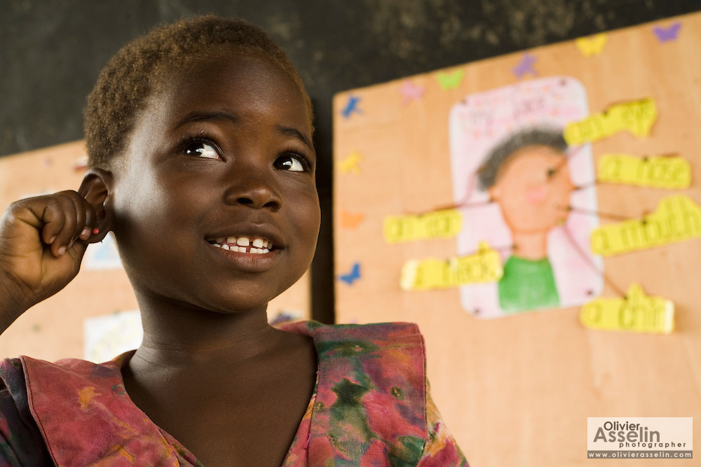 A girl points to body parts as she learns English vocabulary during class at the Kotonli kindergarten in the village of Kotonli, northern Ghana, on Thursday June 7, 2007...